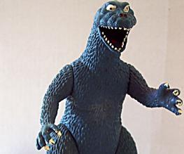 Godzilla snatches Bryan Cranston and Elizabeth Olsen